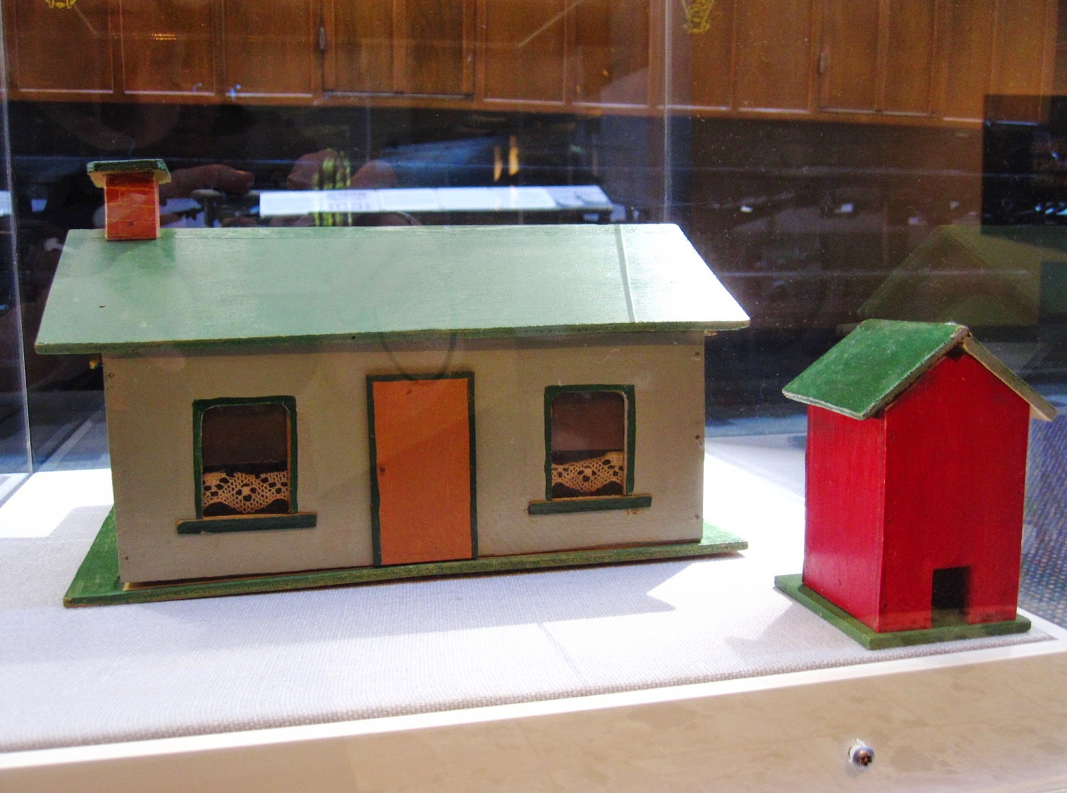 Back view of a vintage toy farm outhouse and house from Sydney shop Walther & Stevenson.