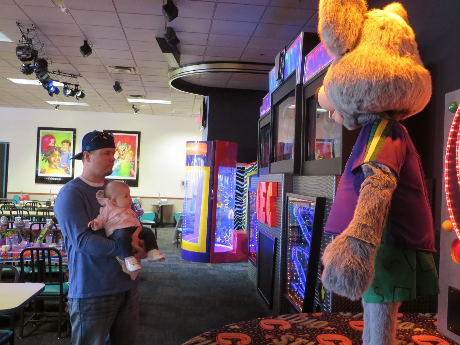 Daddy introducing Charlotte to the Big Cheese himself Chuck E Cheese Games 2014