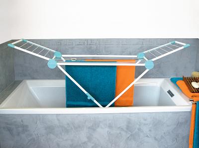laundry drying rack in bathtub