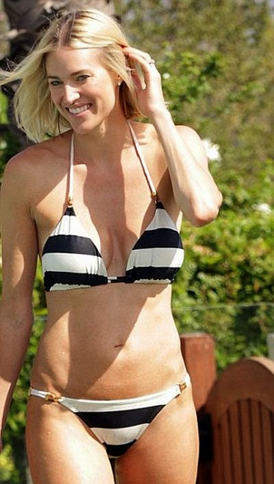 The Real Housewife of New York star showed off her toned and gym hardened body in a White line bikini on Wednesday, August 28, 2014 with family.