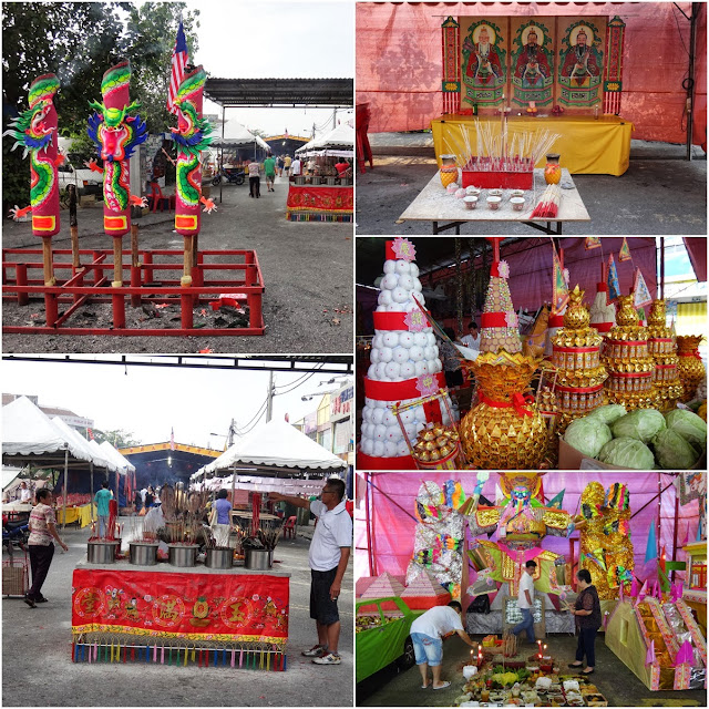 Preparing ritual offerings and burning incense to the ancestors and visiting spirits during Hungry Ghost Festival in Kuala Lumpur, Malaysia