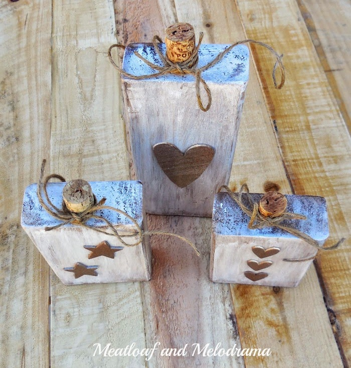 wood block pumpkins with copper heart and stars and wine cork stems