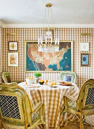 Gingham dining room with tan and cream gingham wallpaper, tablecloth and rattan chairs