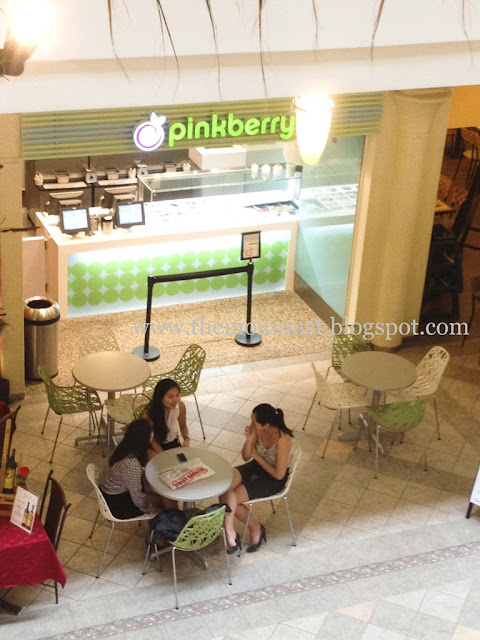 Women chatting outside Pinkberry shop