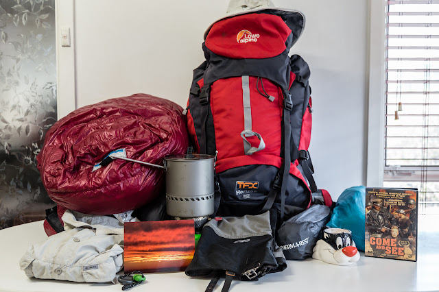 mixture of hiking equipment on table