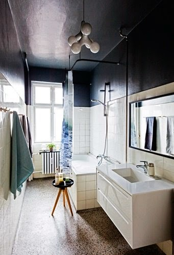 Bathroom with pebble tile floor and black accents