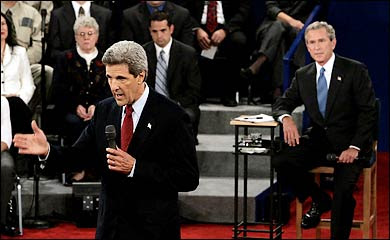 George W. Bush looks on as John Kerry makes a point at the 2004 Presidential debate