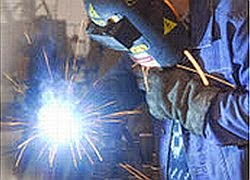 welder with helmet