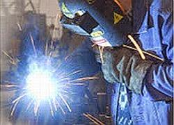 welder with helmet