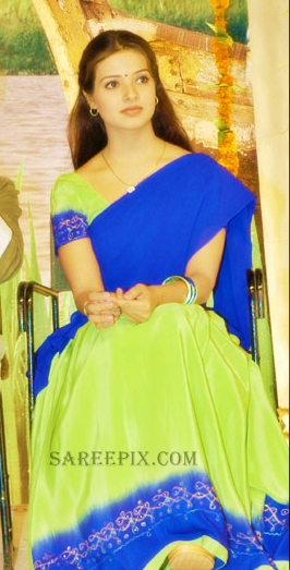 Saloni in half saree sitting pose