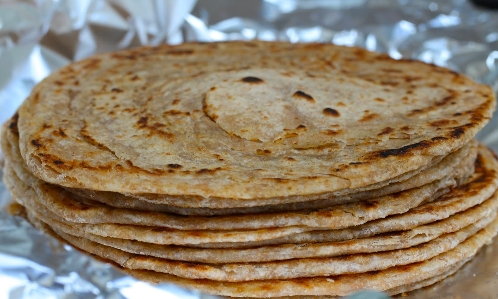 Stack of freshly-made parathas ready to be eaten