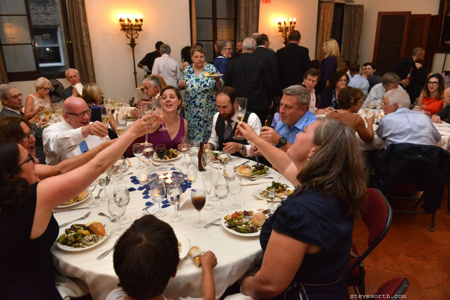 A table toasts to the Bride and Groom - House of the Redeemer