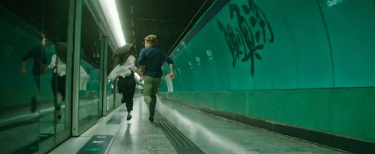 Chris Hemsworth and Wei Tang flee the scene in Blackhat.