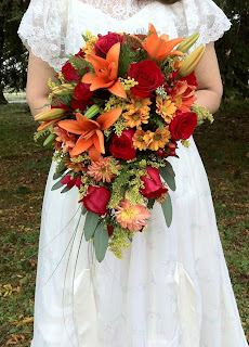 Autumn bridal cascade by Stein Your Florist Co.