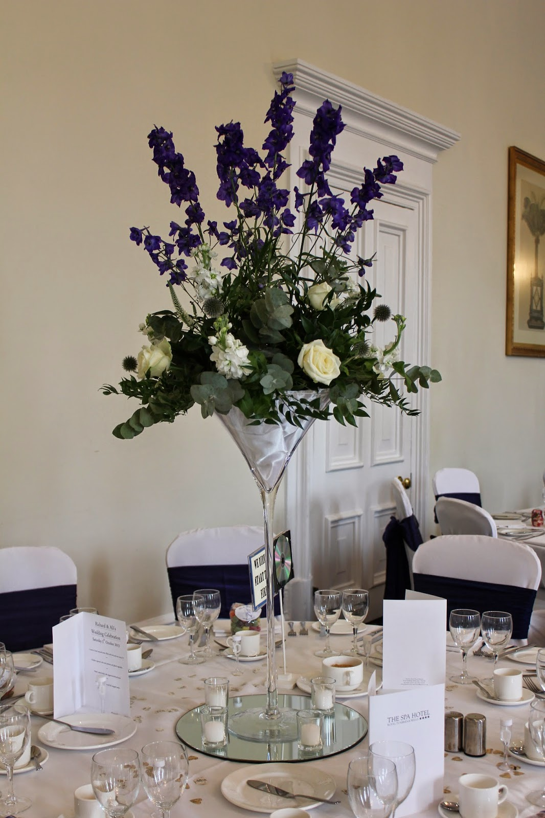 Richard and alis wedding broadview florist martini vase arrangement in shades of cream and royal blue in the royal suite the spa hotel tunbridge wells floridaeventfo Images