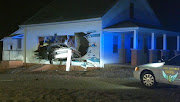 Car Crashes Into, Destroys Side of House