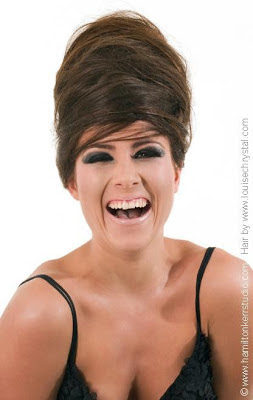 Model laughing, strappy black top, shoulder, high beehive hairstyle, louisechrystal.com