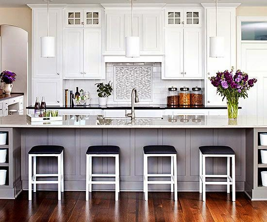 traditional white kitchen with black bar stools white pendant lighting green purple accents