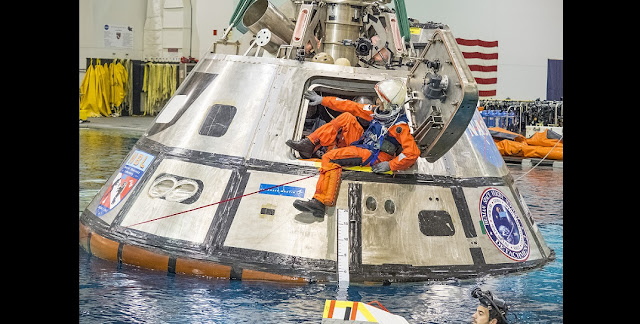 NASA astronaut Suni Williams exits a test version of the Orion spacecraft in the agency's Neutral Buoyancy Lab in Houston. The testing is helping NASA identify the best ways to efficiently get astronauts out of the spacecraft after deep space missions. Credits: NASA