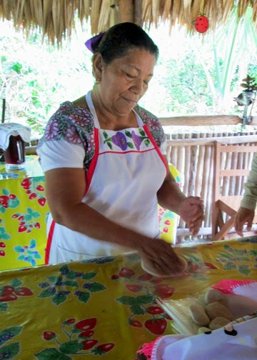 Our tour guide explained the process of turning corn into flour as a Mayan woman demonstrated how to make corn tortillas. Modern Mayans speak the Mayan language as well as Spanish. (Many younger generation Mayans speak English as well.)