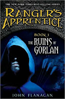 the cover of The Ruins of Gorlan by John Flanagan book one in the ranger's apprentice series shows a hooded man with a quiver full of arrows bathed in blue moon light