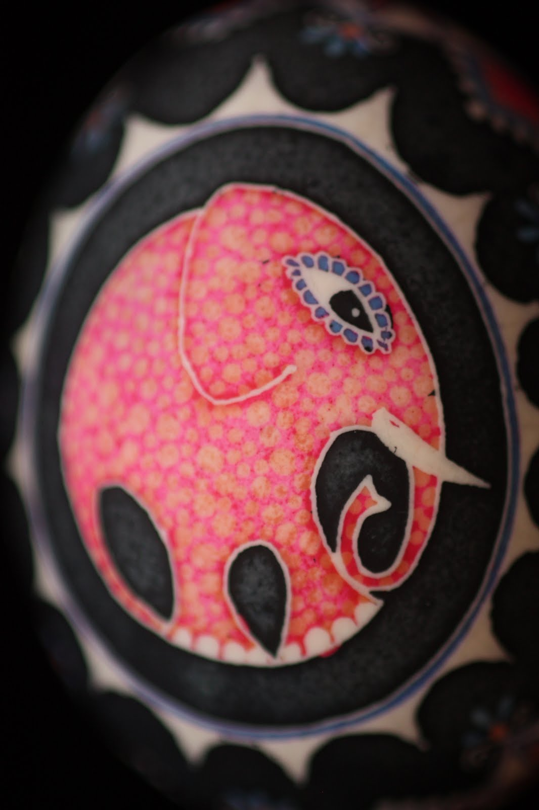 Pink Polka Dotted Elephant Ukrainian Egg with Terra Cotta and Blue on Black Background