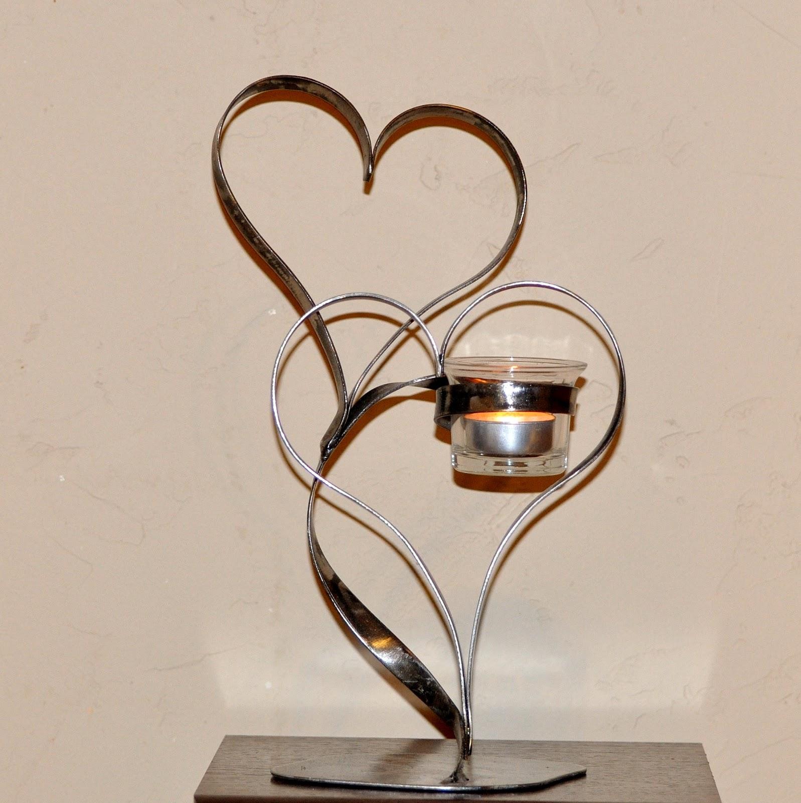 cr ateur d 39 objets d co en fer forg bougeoirs luminaires porte bouteille. Black Bedroom Furniture Sets. Home Design Ideas