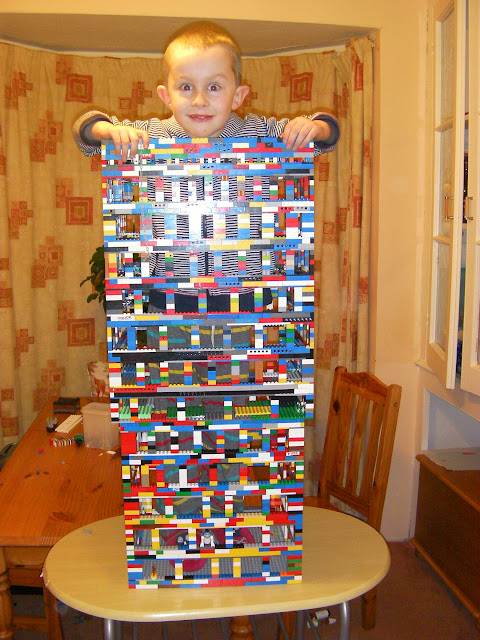 giant lego building with a boy in it