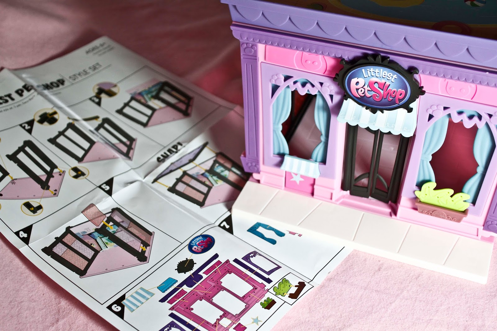 simple to follow instructions with the completed littlest pet shop building next to the littlest pet shop style set