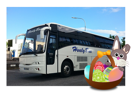Easter Bunny with basket of eggs photo-bombing a picture of a Healy bus in the sunshine