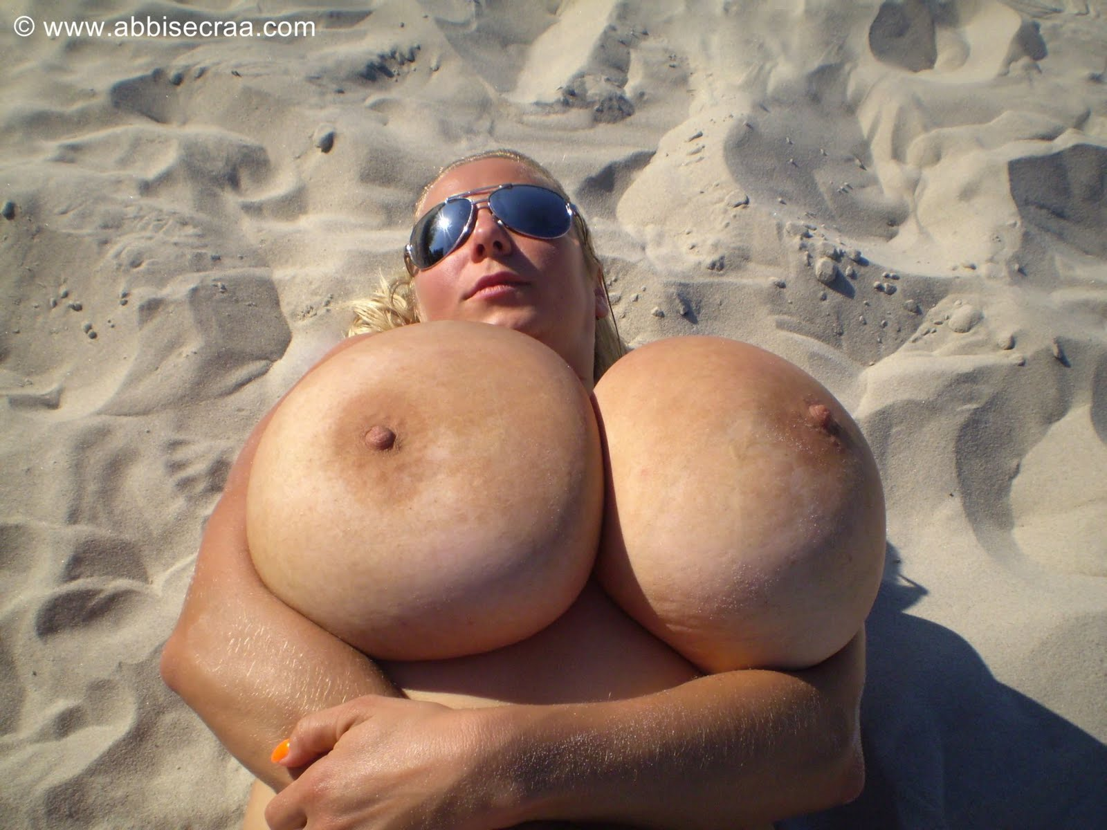 Ass huge hot boobs topless on the beach and