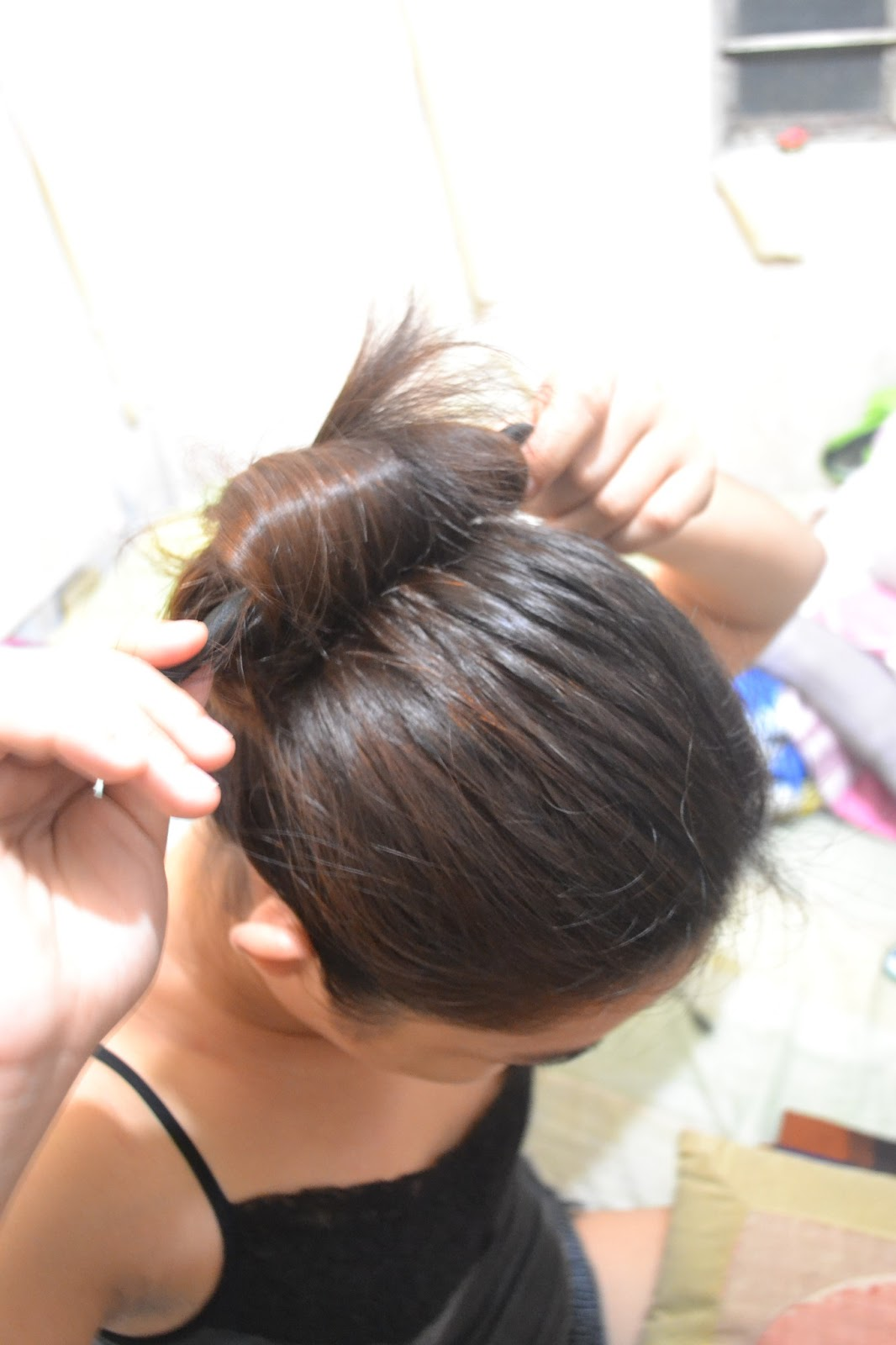 how to use a hair donut to make a bun