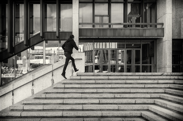 A man runs up the steps outside Artscape in Cape Town