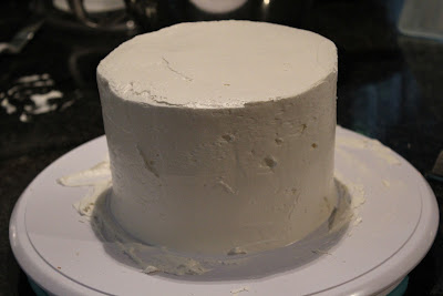 Frosting a layer cake
