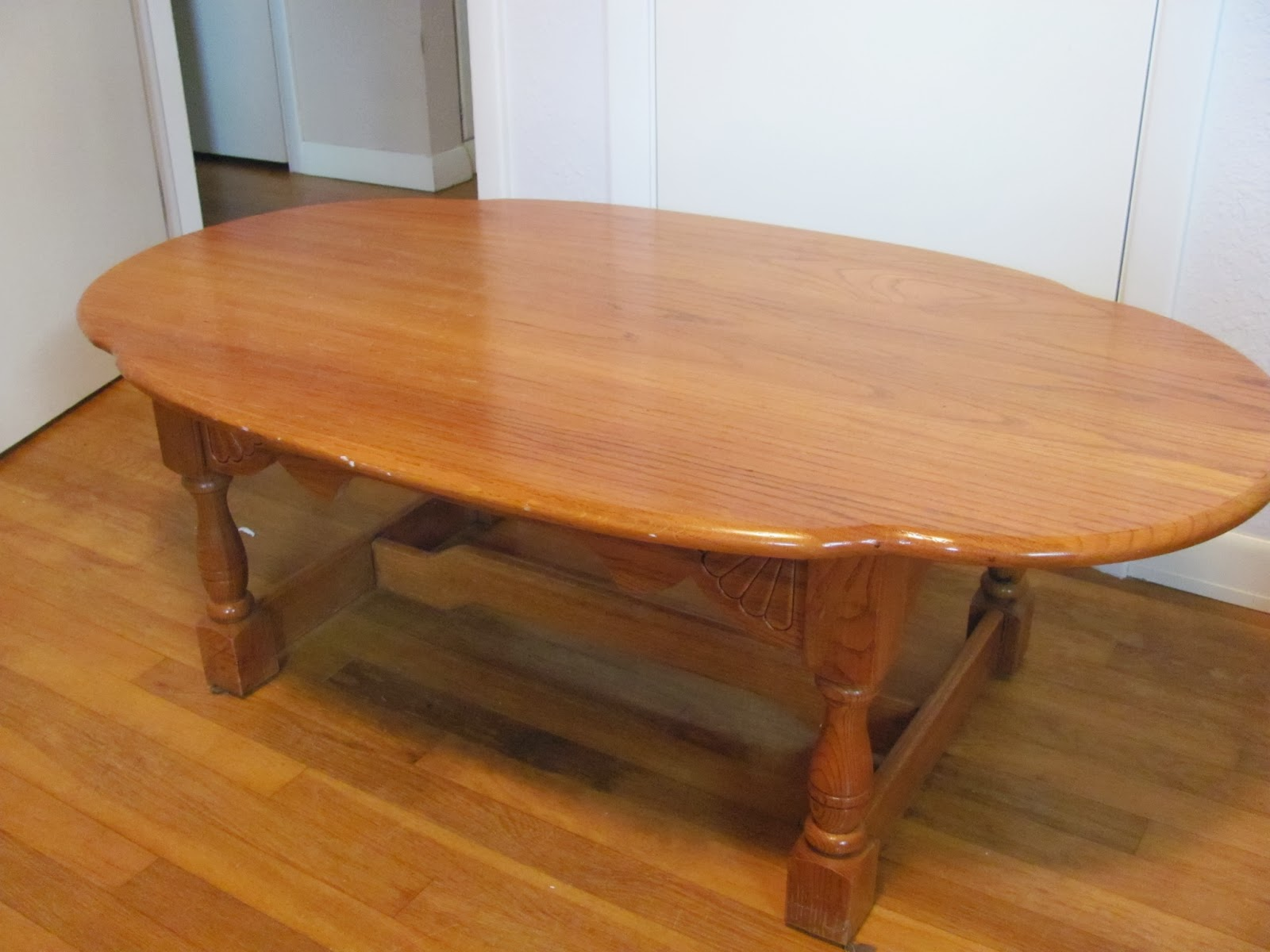 Angle view of the large wooden coffee table before being sold on Craigslist