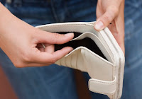 two hands holding an empty white wallet