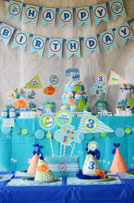 Amanda 39 s parties to go rainbow fish inspired party for Fish party supplies