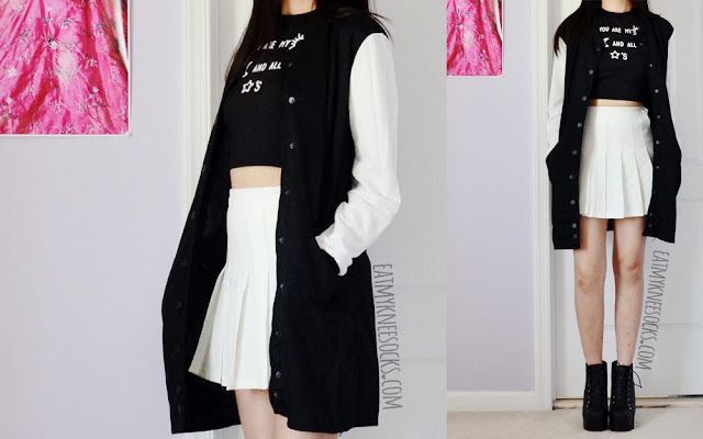 A sporty-casual ulzzang-style black-and-white outfit, featuring Dresslink's longline baseball jacket and printed crop top, worn with a white American Apparel pleated tennis skirt.