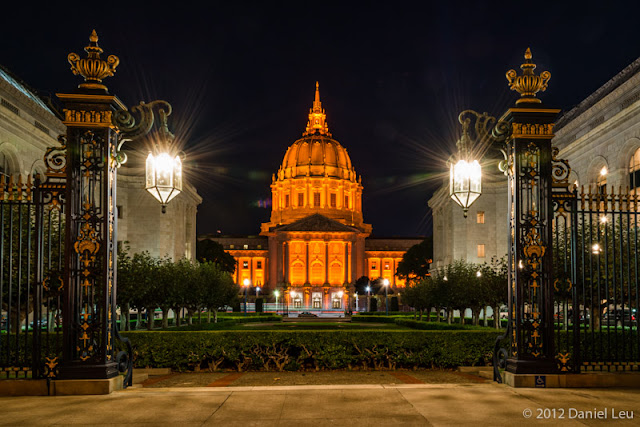 San Francisco City Hall glowing in orange