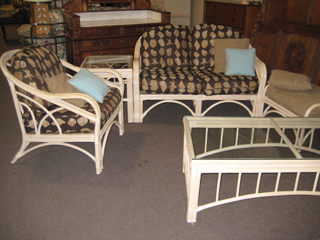 Captivating Benchcraft Rattan Sofa/Loveseat, Chair/Ottoman, Coffee/2 End Tables    $699/set