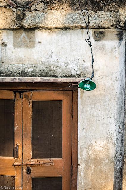 Green bulb and orange door