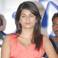 gorgeous and splendid Shraddha das in red cocktail dress latest hot hq stills