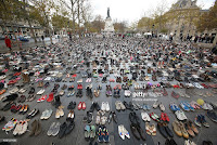 The place de la Republique is covered with shoes as part of symbolic rally organized by the NGO Avaaz during the forbidden COP21 demonstration on November 29, 2015 in Paris, France. The demonstration was banned after the Paris terror attacks on Friday, November 13th. Nevertheless, thousands of people gathered to protest against global warming ahead of COP21conference and an estimated 200 people were arrested after fighting with police. November 29, 2015 (Credit: Patrick Aventurier) Click to Enlarge.