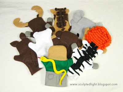 Zoo animal puppets. Back view.