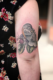 bird tattoo with berries