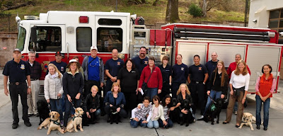 puppy club with firemen in front of firetruck