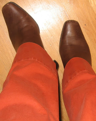 brown ankle boots with orange pants