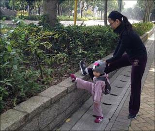 girl imitating her mother