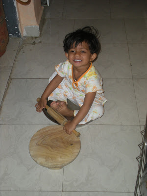baby photograph making chapati