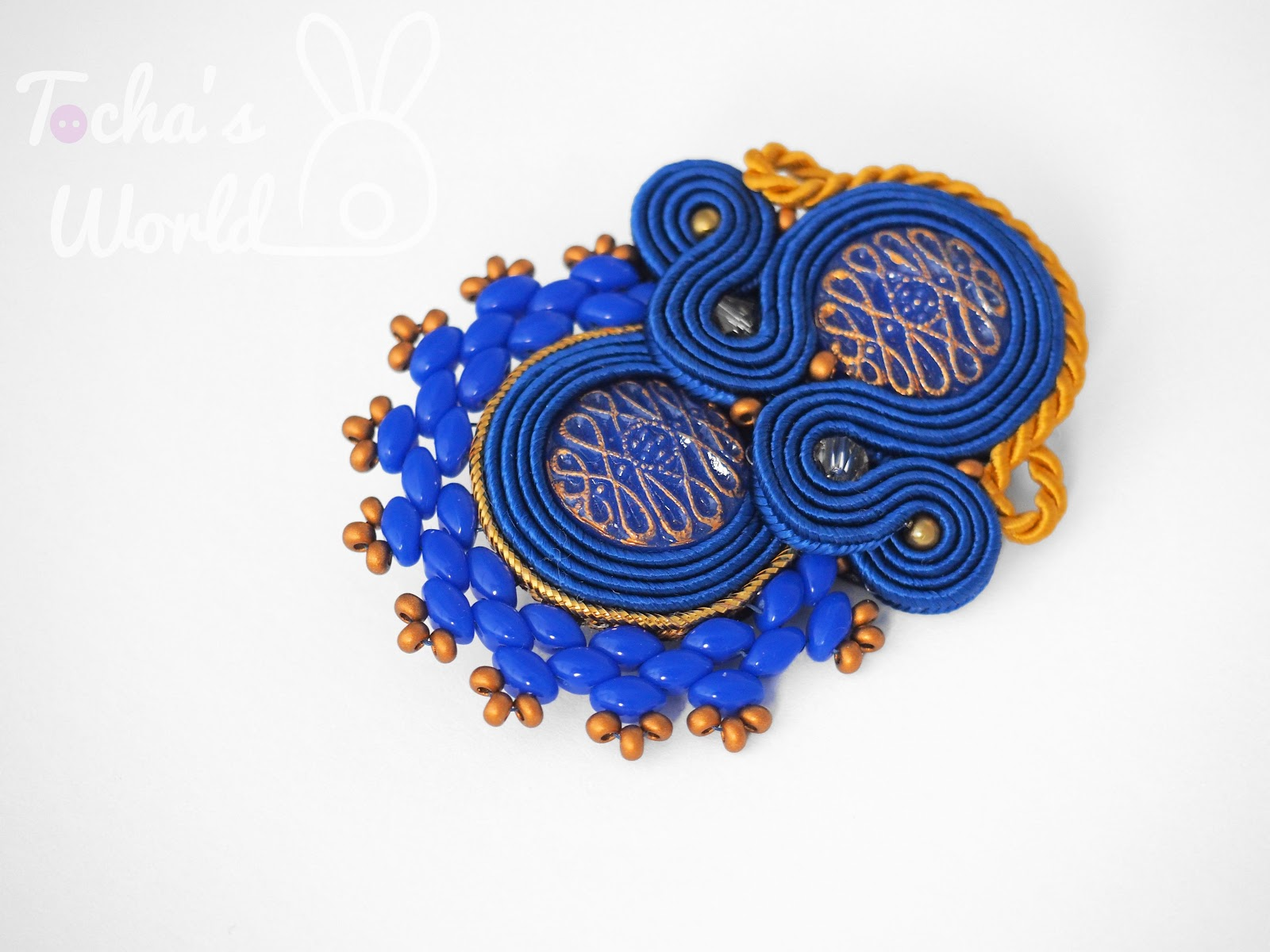 soutache, vegan, animal-friendly, animal rights, animal welfare, beadwork, glass buttons, vintage, ultrasuede, brooch, royal blue, nautical, golden, twin beads, Preciosa, Czech beads, viscose,